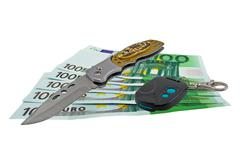 European banknotes, Pocket knife and Car trinket Stock Photos