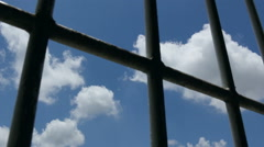 Pan shot of view trough prison window - stock footage