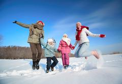Family in snowdrift - stock photo
