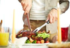Cutting meat Stock Photos