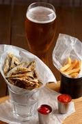Sprat and french fries with gravy Stock Photos
