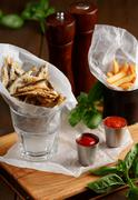 Sprat and french fries with gravy - stock photo