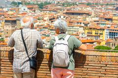 Stock Photo of Tourists admire the view of Florence from Fort Belvedere.