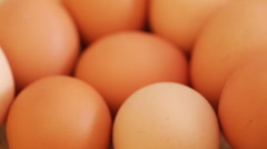 Hen eggs on rotating stand - closeup Stock Footage