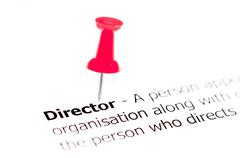 Word DIRECTOR pinned on white paper with red pushpin, available copy space Stock Photos