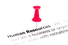 Words HUMAN RESOURCES pinned on white paper with red pushpin - stock photo
