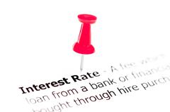 Words INTEREST RATE pinned on white paper with red pushpin - stock photo