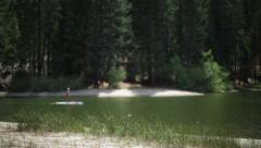 Paddle boarding on the lake Stock Footage