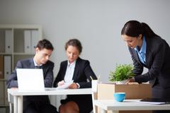 Businesswoman packing things - stock photo
