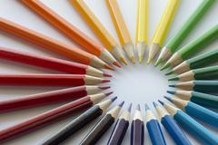 Color circle of pencils with complementary colors Stock Photos