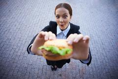 Female with snack Stock Photos