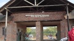 Masai Mara national reserve gate entrance, Savannah safari Kenya Stock Footage