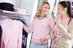 Choosing new pullover Stock Photos