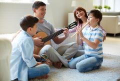 Musical family - stock photo