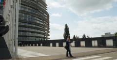 European Parliament in Strasbourg with all European Countries Flags Stock Footage