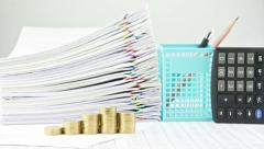 Step pile of gold coins and stack paperwork time lapse - stock footage