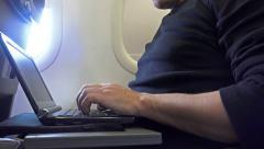 4K Keyboard-level shot of man hands using laptop during airplane flight Stock Footage
