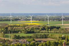 Flat west German landscape near Aachen and Herzogenrath with wind turbines in - stock photo