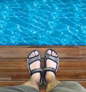 Black sandals on wood Stock Photos