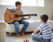 Learning how to play the guitar - stock photo