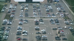 Parking lot full of cars and peoples near the shopping area Stock Footage