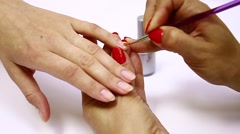 Application of the gel coating to the nails - stock footage