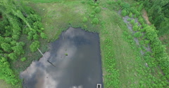 A Flight over a Stagnant Pond between a Shopping Center and a Subdivision (4K+) - stock footage