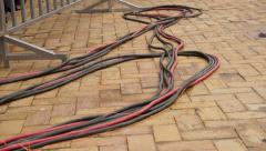 Electrical Power Cables on Ground at an Event Stock Footage