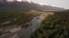 Aerial Scenic Sunset Light over Alaskan River Forest Mountains HD Stock Footage