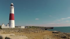Portland Bill lighthouse with the bird observatory lighthouse in the background Stock Footage