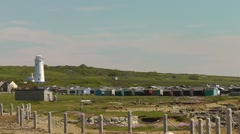 Bird observatory at Portland Bill, UK with beach huts in the foreground Stock Footage