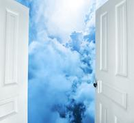 White doors opening to dreams and success Stock Photos