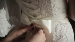 Bridal corset is being tied up Stock Footage
