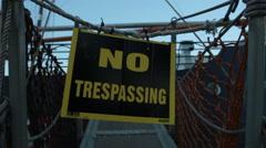 Slow Push In On Gangplank And No Trespassing Sign - stock footage