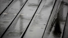 Rainwater on a wooden floor at terrace Stock Footage