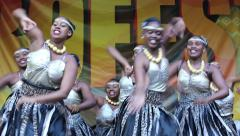 Beautiful women in national costumes perform traditional African dance. Stock Footage