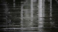 Raindrops on a wooden floor Stock Footage