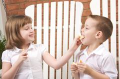 Sister and Brother Having Fun Eating an Apple Stock Photos