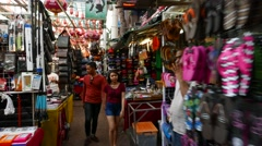 Covered market street narrow passage, walk through stalls Stock Footage