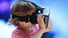 Virtual reality game. The little girl with surprise uses head-mount display. Stock Footage