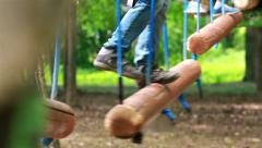 Sports enthusiasts are engaged in activities in the rope park. Stock Footage