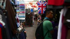 T-shirt with UK flag on the market, move forward through aisle Stock Footage