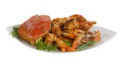 Spicy cooked crab ready to serve on white background Stock Photos