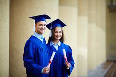 Friends with diplomas - stock photo