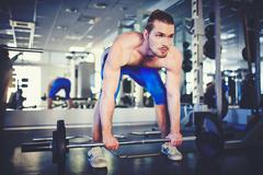 Weightlifter in gym - stock photo