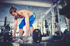 Strong weightlifter - stock photo