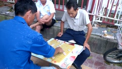People play Chinese chess in Shenzhen, China Stock Footage
