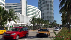 Road traffic in Collins Avenue at Miami Beach (Millionaires' Mile) Stock Footage