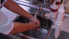Woman washes her hands with soap and water Stock Footage
