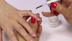 Manicure. On the basis of a nail varnish is applied Stock Footage